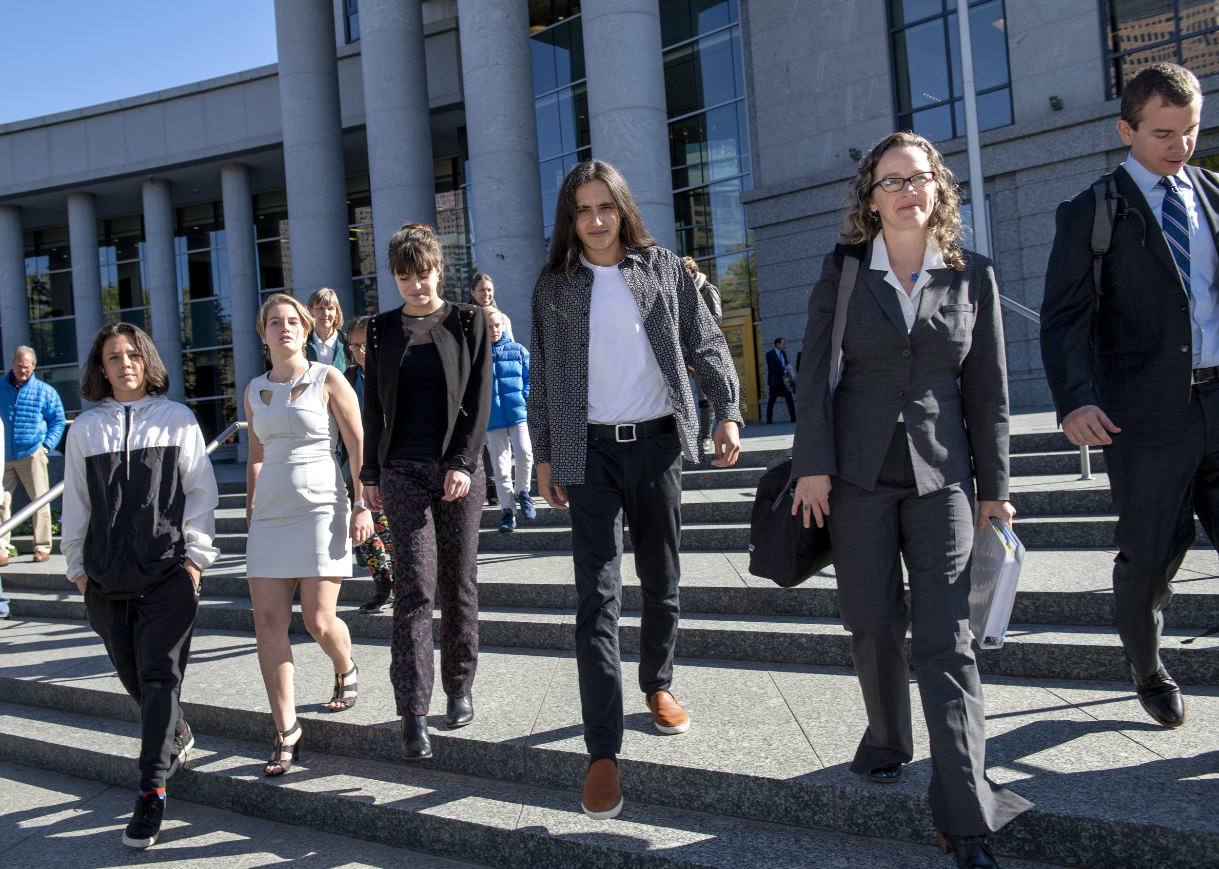 From left, youth plaintiffs Itzcuauhtli, Emma, Aerielle, and Xiuhtezcatl leave the Colorado Supreme Court with their attorneys Julia Olson and Nate Bellinger after oral argument in their climate lawsuit against the Colorado Oil and Gas Conservation Commission on October 16, 2018 in Denver, CO.