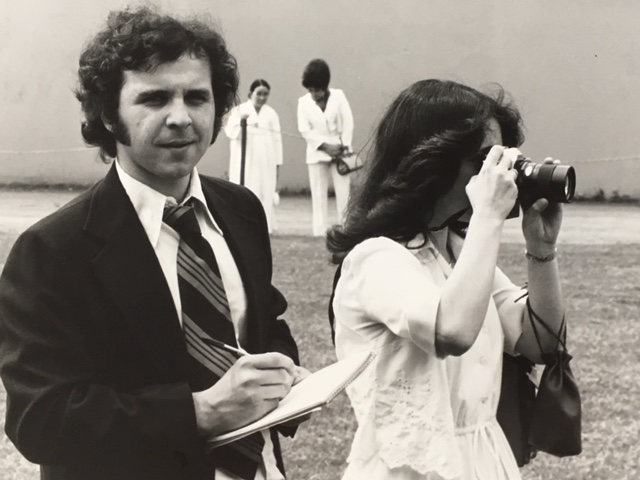 On the media beat (and in need of a haircut) at the University of Lowell Commencement, now UMass Lowell, at Cawley Stadium with Leslie Kaplan, 1979.