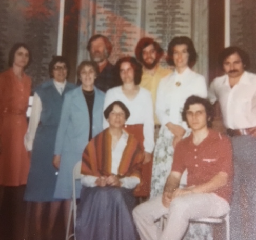 Members of the Poets' Lab gathered for a group reading at Memorial Hall Library, Andover, Mass., 1977. Back row, from left, Kathleen Aponick, Alice Davis, Stephen Perrin, Charles Brunault, Mary Tremblay, Wayne Nalbandian; middle row, Florence Liberfarb, Anne Fleming; Seated, Cynthia Ward, PM.