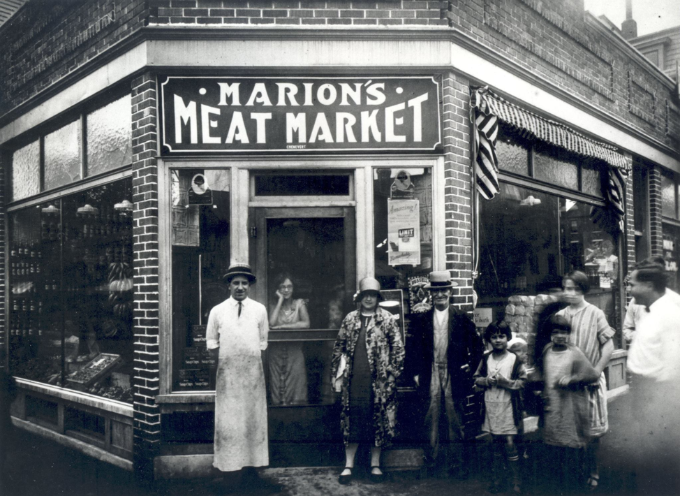 Marion's Meat Market, Little Canada neighborhood, Lowell, around 1926. Wilfrid Marion, grandfather of PM, is in the long white butcher's apron in front. The other persons are unidentified.