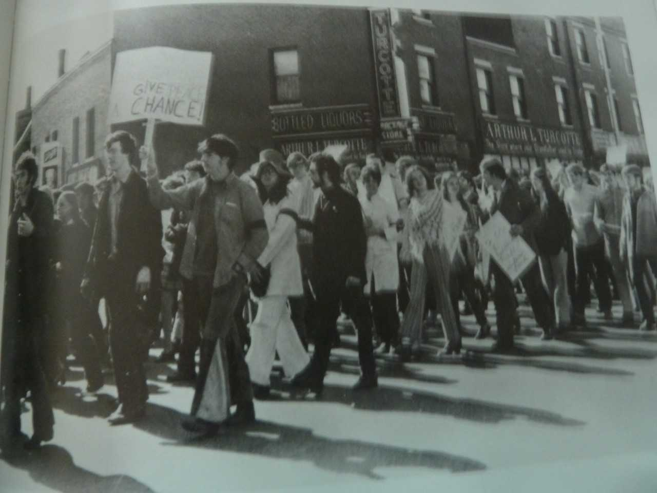 Students from the two colleges in Lowell marching for peace. (Courtesy of UMass Lowell, from  To Enrich and to Serve: The Centennial History of the University of Massachusetts, Lowell , by Mary H. Blewett and Christine McKenna [Dunlap])