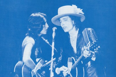 Joan Baez & Bob Dylan singing at Costello Gym in Lowell, Nov. 2, '75. Photo courtesy of UMass Lowell.
