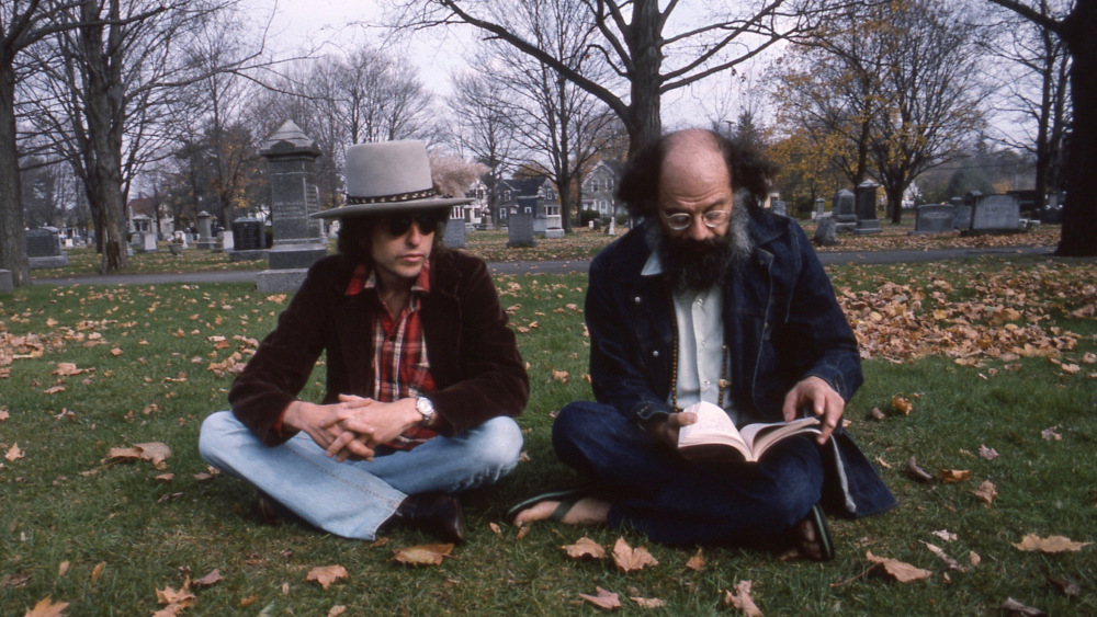 "Dylan and poet Allen Ginsberg at Jack Kerouac's grave in Edson Cemetery, Nov. 3, 1975. Photo courtesy of ""Bob Dylan's Rolling Thunder"" by film director Martin Scorsese."