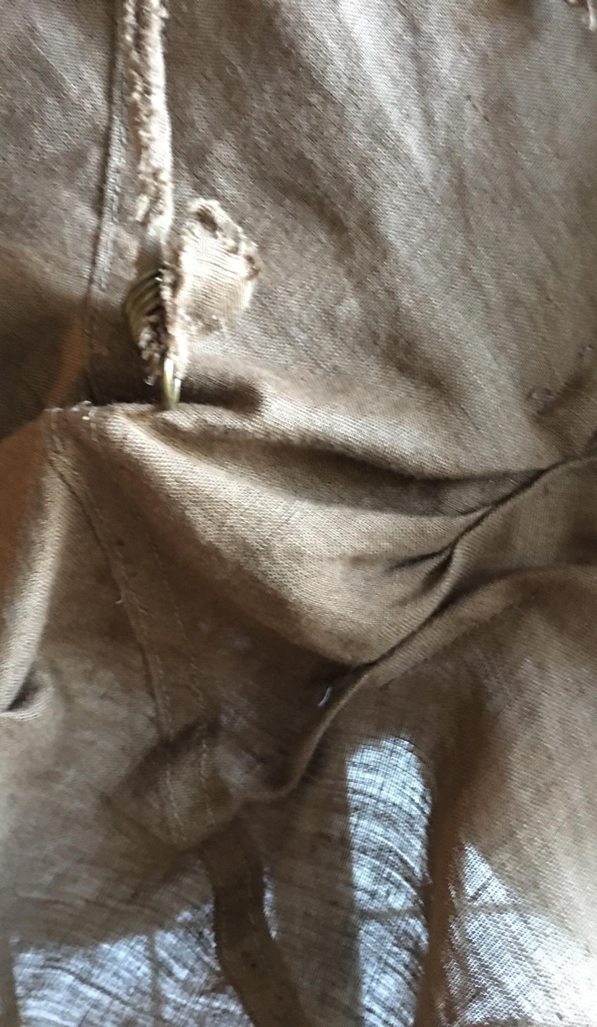 tucks on brown dress at hem.jpg