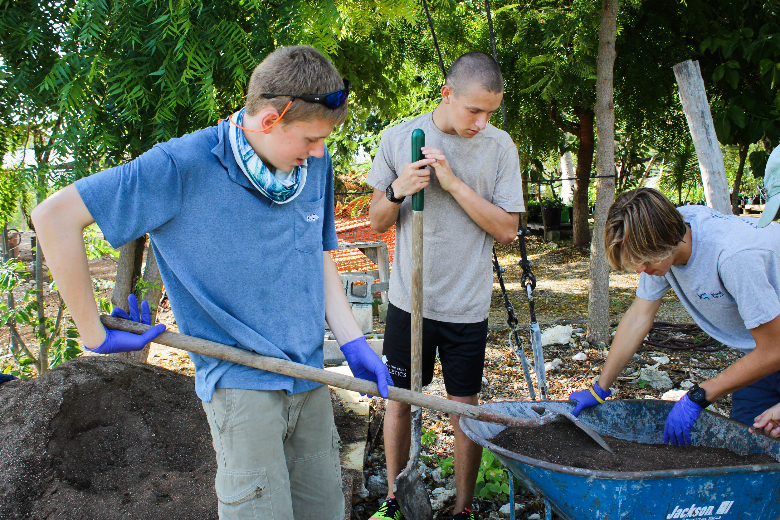 Island School students working to construct the Research Garden in which their research class will be focused.