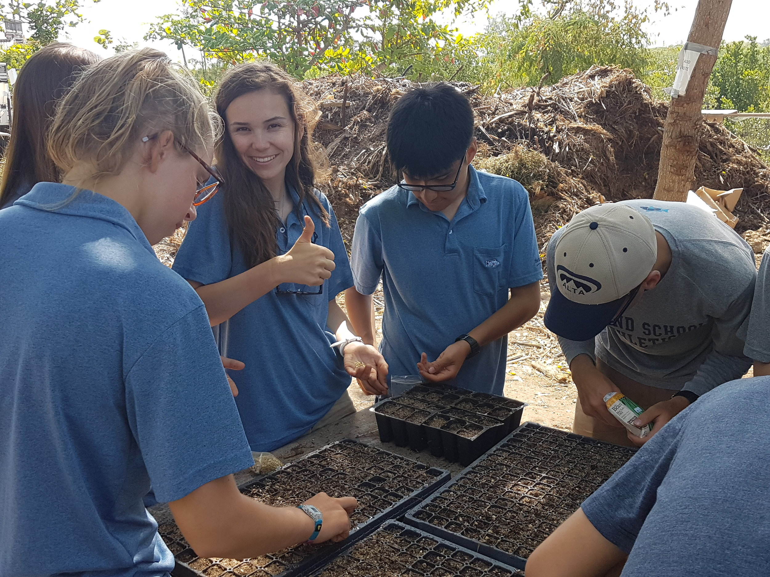 The Research team plants seeds to then be transplanted into the new grow beds in the farm.