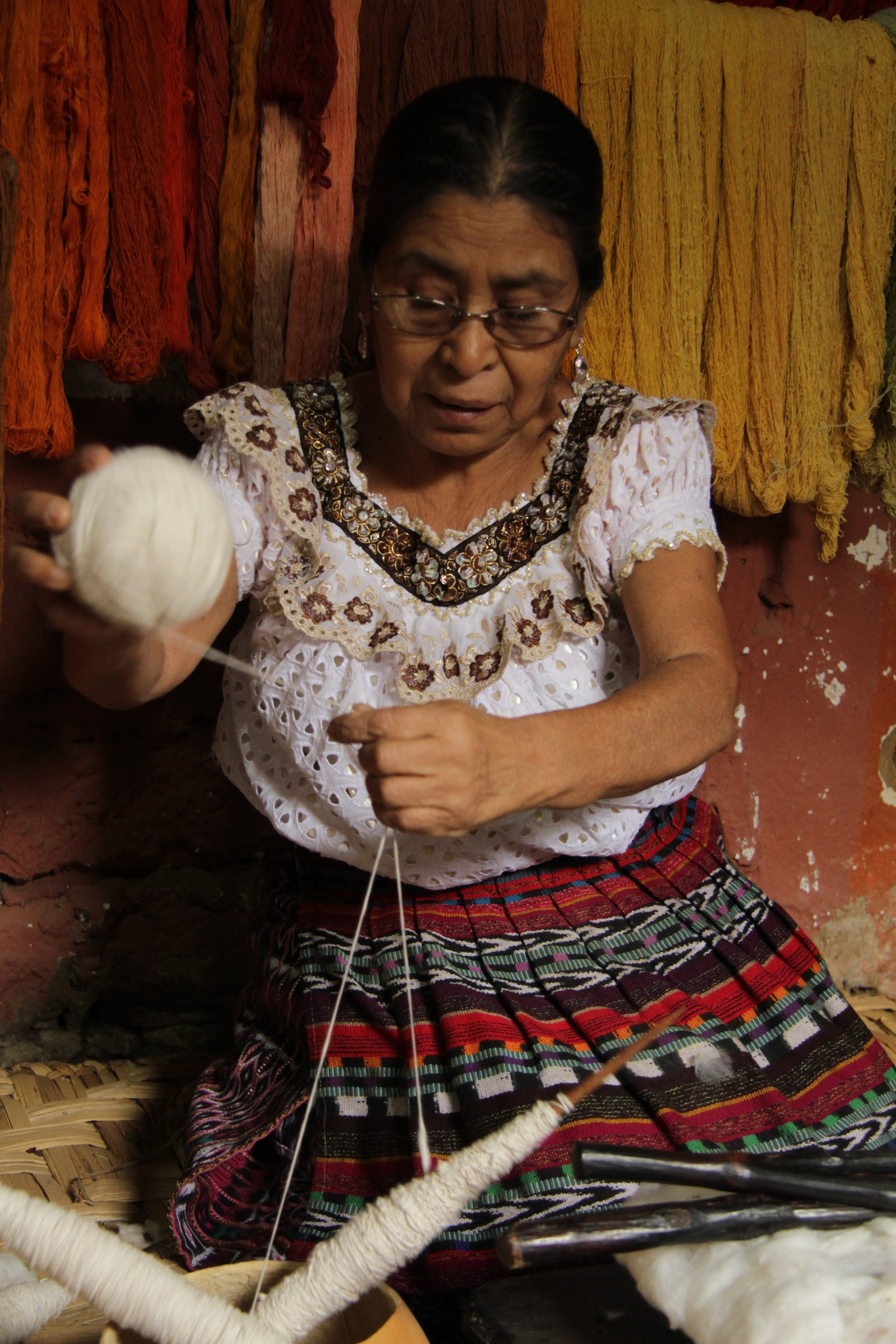 Once the cotton is spooled, they create the ball of yarn.  It takes about  4 hours  to roll two spools into one ball of yarn.