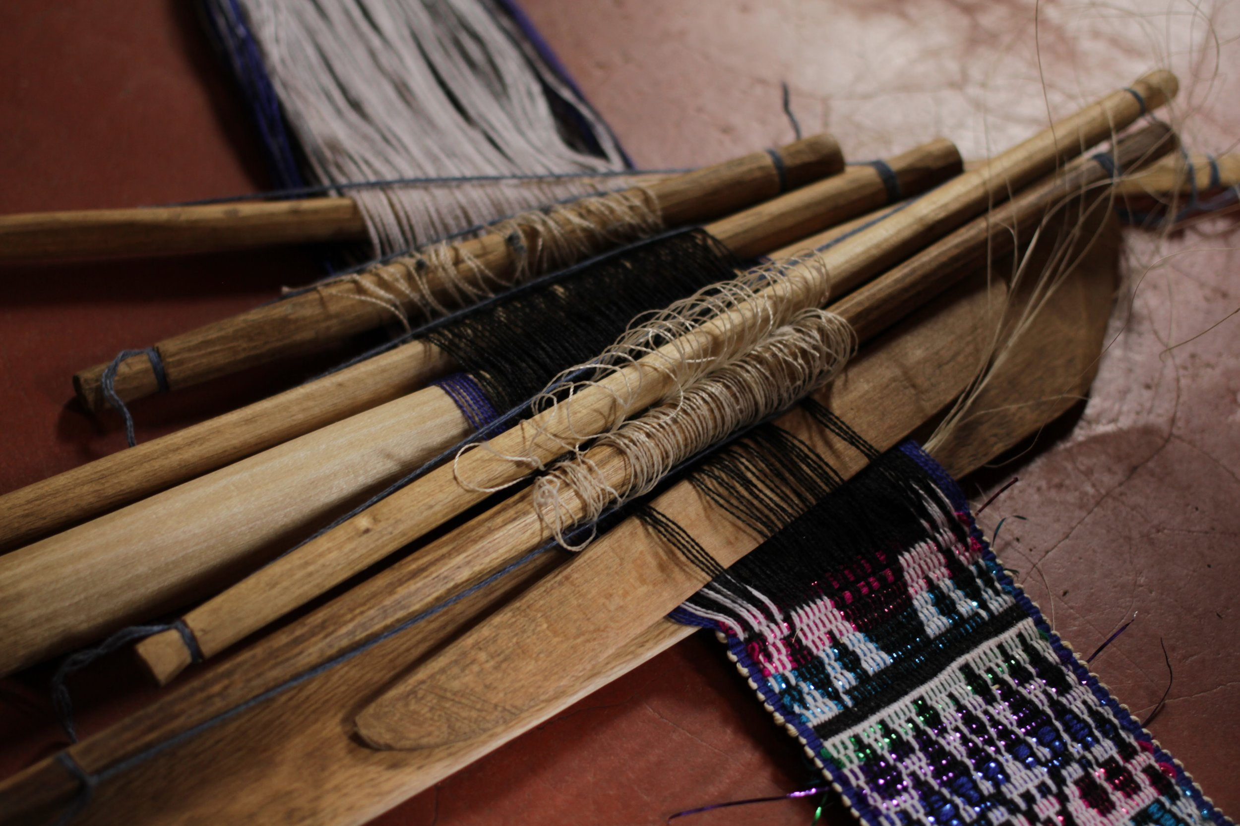 Finally they are ready to weave! The artisan will decide what patterns she wants to create, and will choose the appropriate number of rods to support it.   The greater the number of rods, the more complex the design.