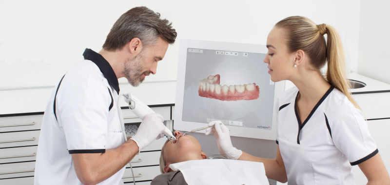 doctor demonstrating orthodontic scanner