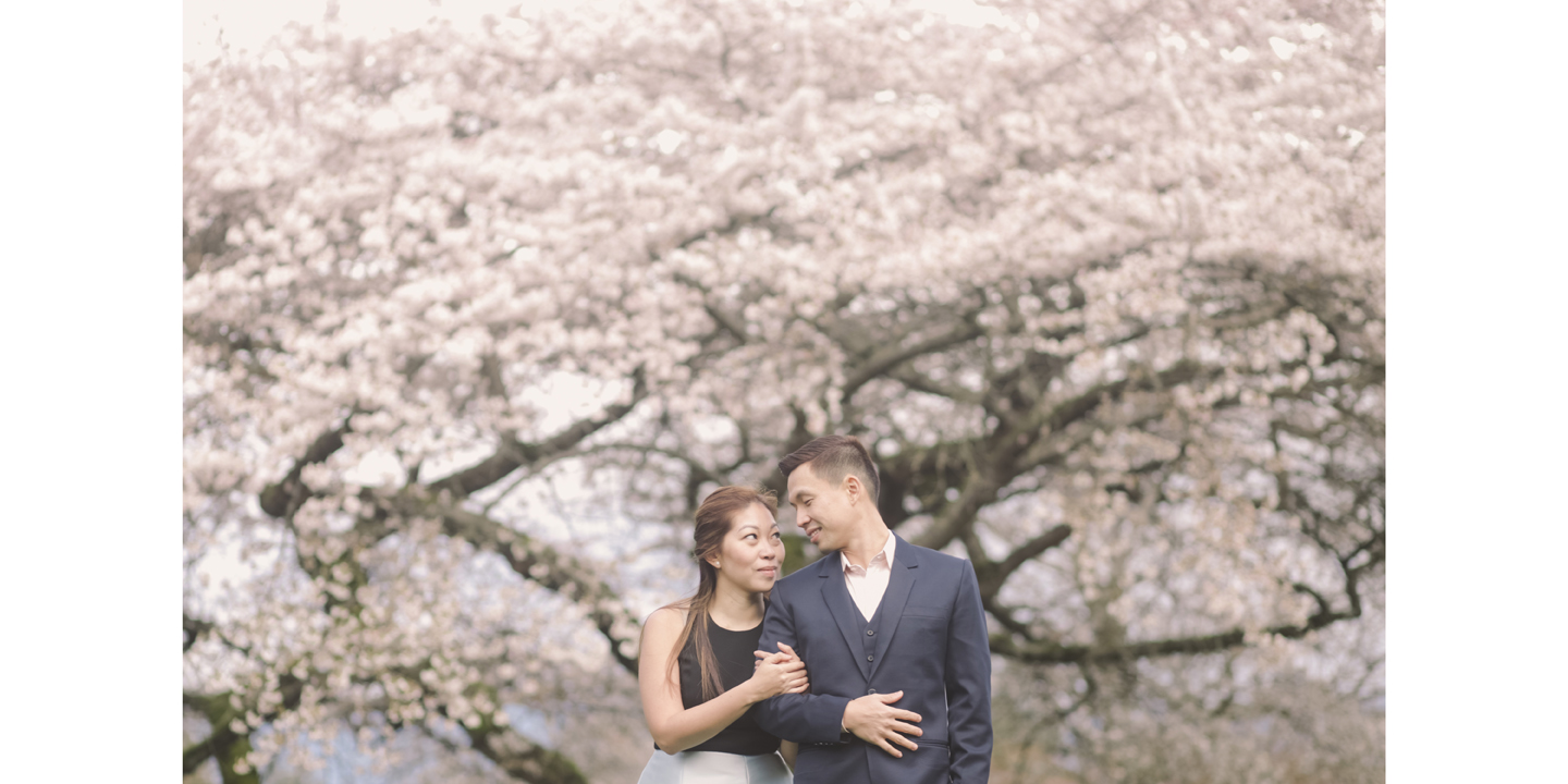 Rainier-Pauline-Jacinto-under-cherry-blossoms-in-ubc-rose-garden-spring-session-engagement