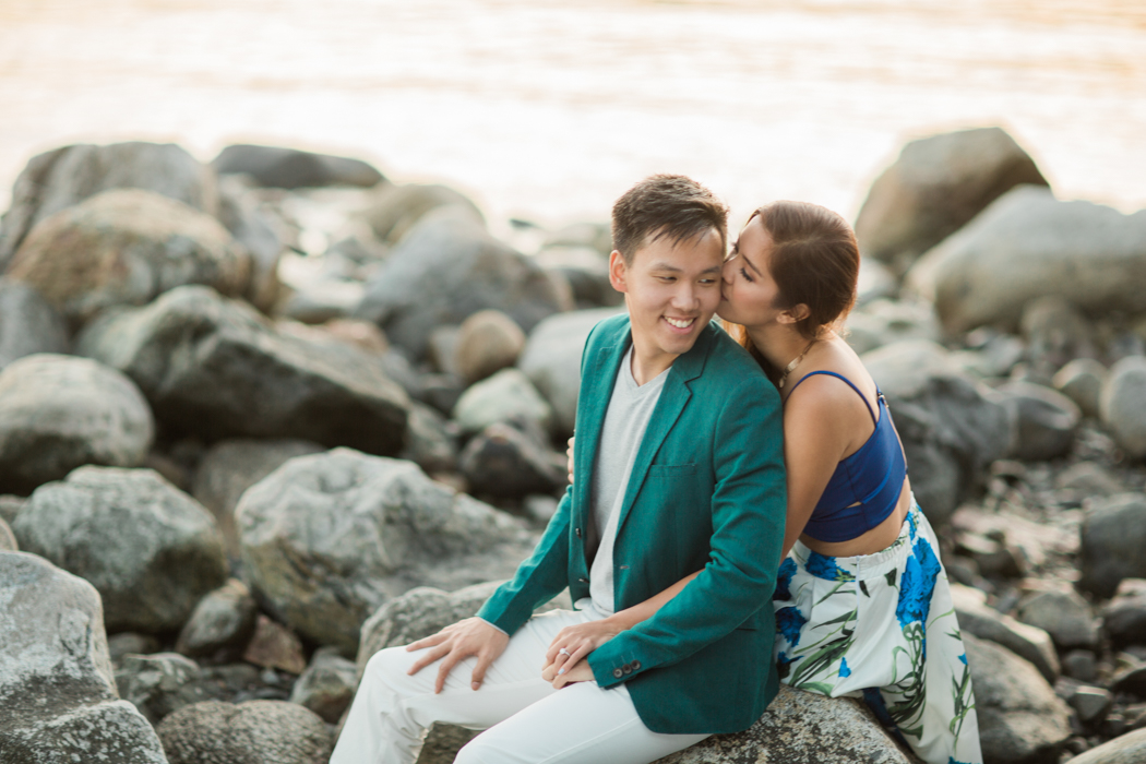 girl-kissing-boy-on-cheek-tenderly-at-whytecliff-park-west-vancouver-engagement-photoshoot-destination-shoot-vancouver-bc