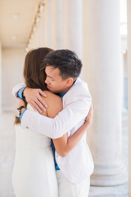 couple-embracing-at-legion-of-honor-engagement-photoshoot-all-white