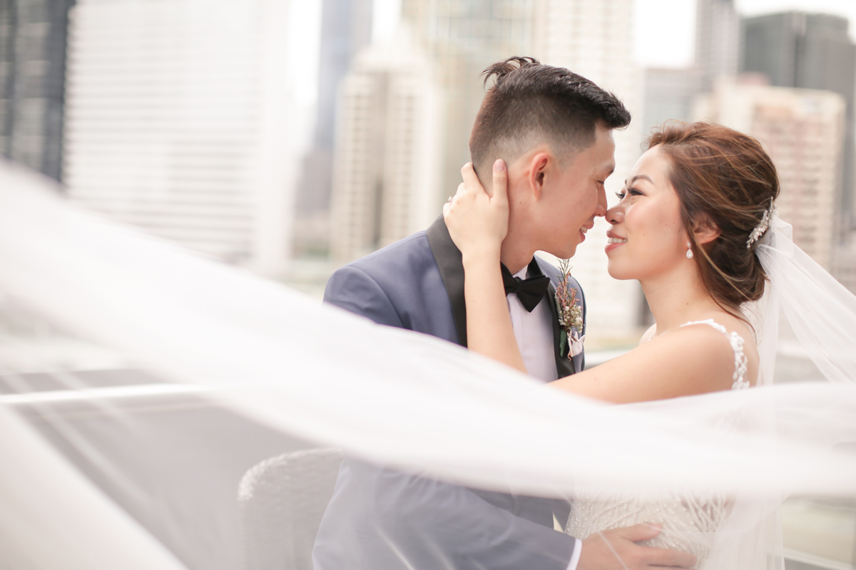 bride-groom-hold-each-other-close-macy-yap-photography