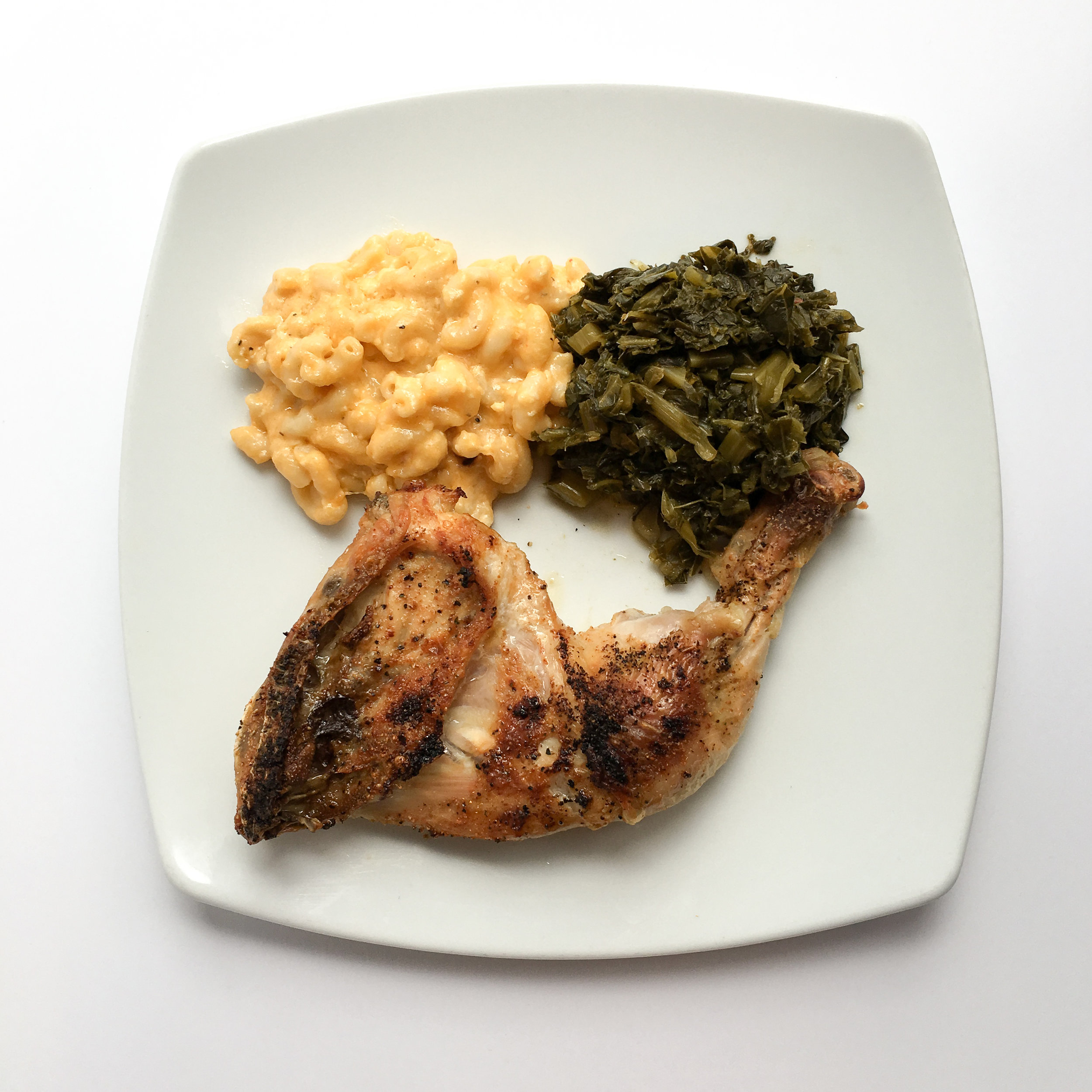 Broiled Chicken, Backed Mac and Cheese and Collard Greens.