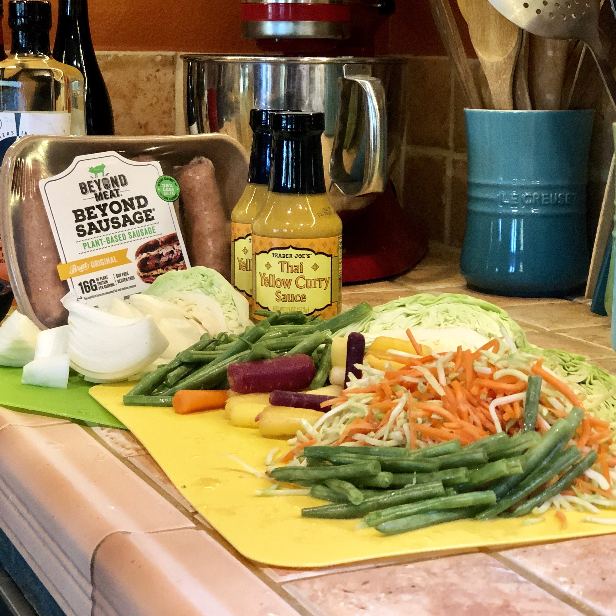 Beyond Sausage, TJ's Yellow Curry Sauce, sliced onion, green beans, multi colored carrots, broccoli slaw, cabbage.