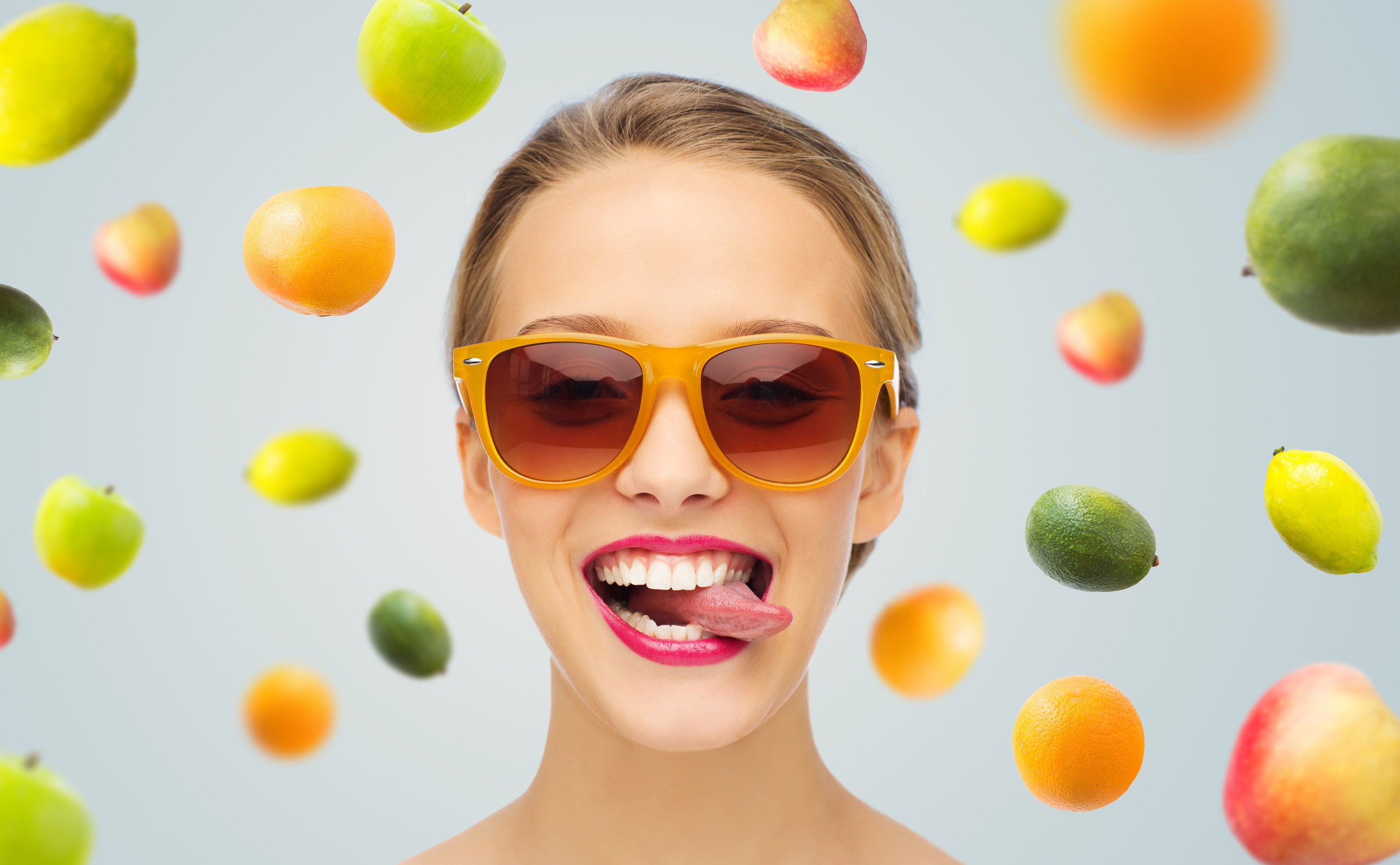 50781435 - people, expression, joy and fashion concept - smiling young woman in sunglasses with pink lipstick on lips showing tongue