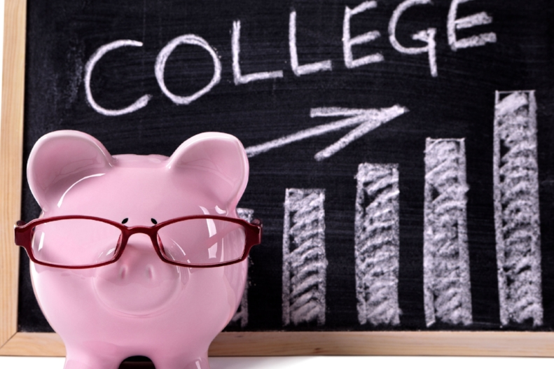 37535897 - pink piggy bank with glasses standing in front of a blackboard with simple college savings or fees chart.