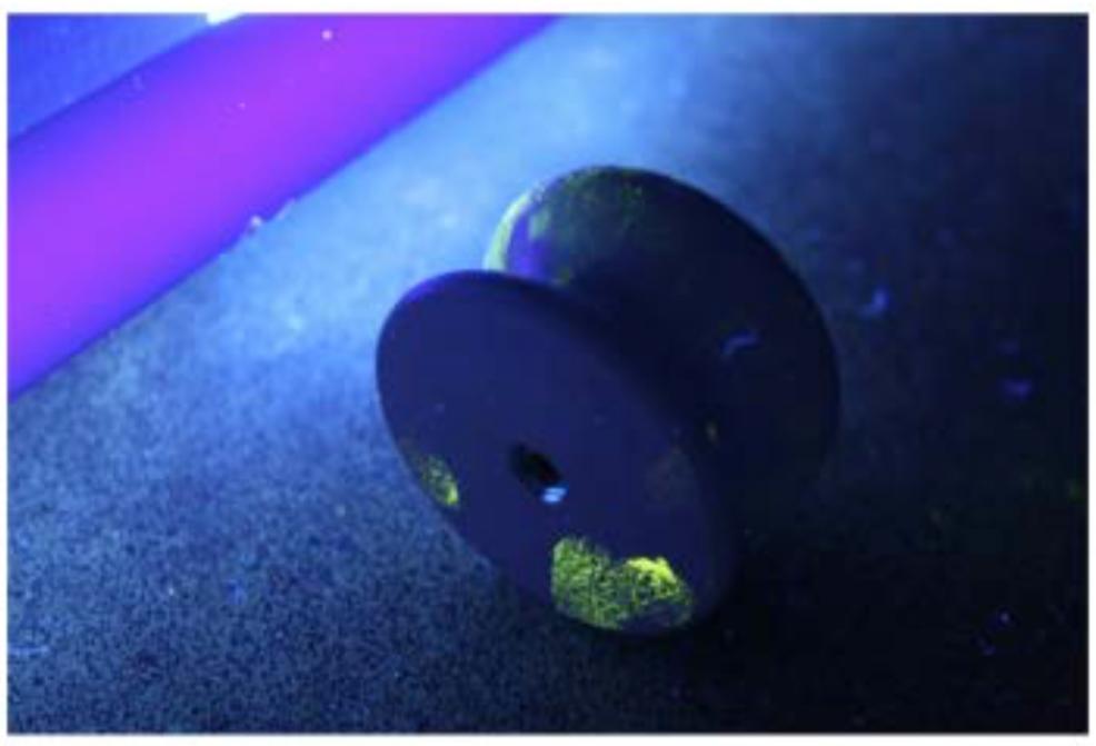 Cerise powder fingerprints on white door knob 2.png