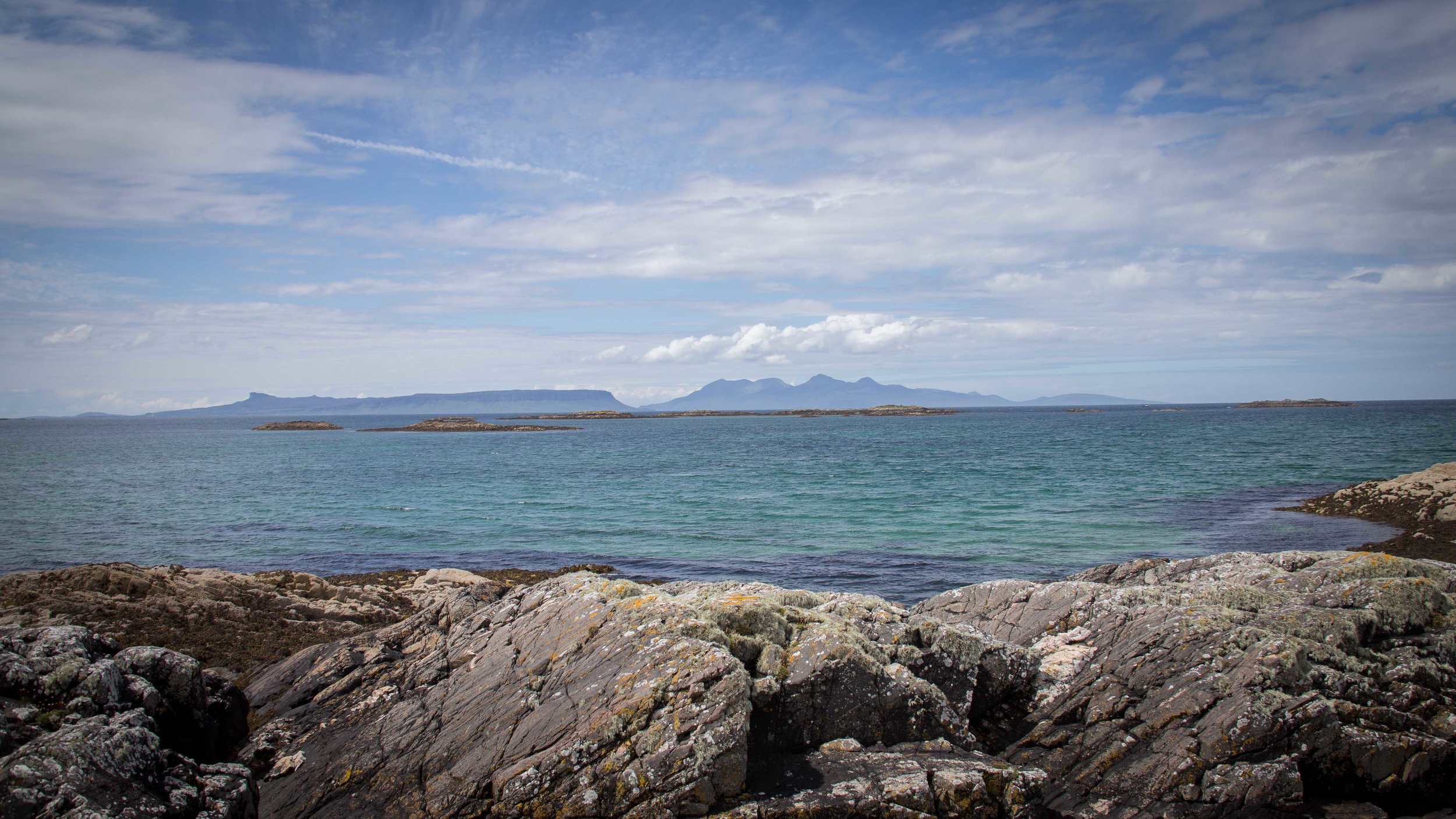 Two of the Small Isles, Eigg (on the left) and Rum (on the right). Locals used to have a superstition of not referring to the islands by their names. Instead they called Eigg the 'Island of the Big Woman'. Apparently a tribe with women of Amazonia stature used to repel those attempting to land on their island. A similar tale is told of Rum, or the 'Forbidden Island', here the islanders used guns to deter visitors. I'm sure both are much more friendly today. Rum's skyline looks similar to that of the Cullins. Both ridges share similar geology and it was the Viking rulers of Rum that gave the Cullins their name.