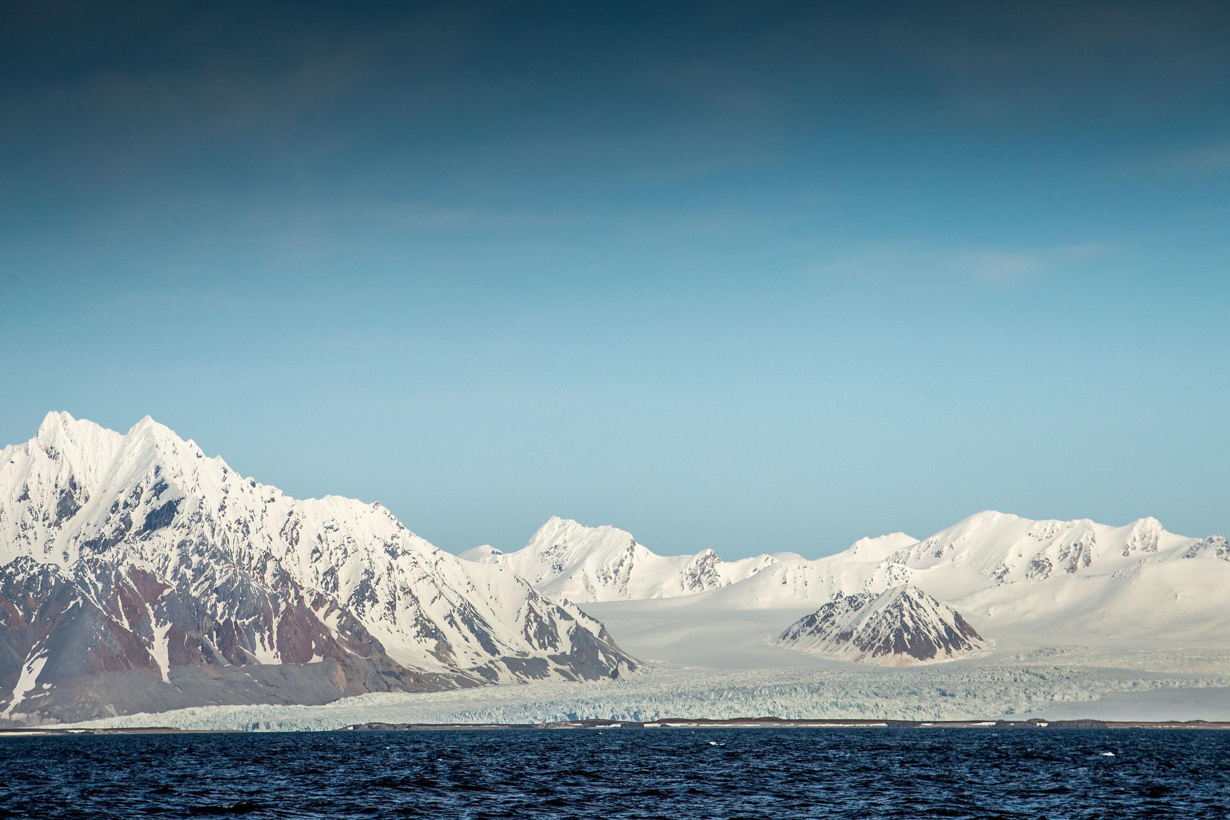 Sailing past glaciers on the west coast of Spitzbergen