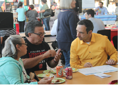 Alianzas Director, Gerardo Martinez, talks with attendees of the Branson Binational Health Fair. Photo credit: Alianzas