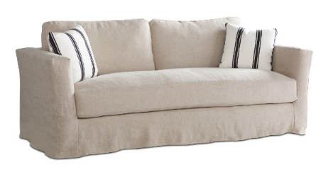 The square arm, softly tailored look of a Reece slip covered sofa