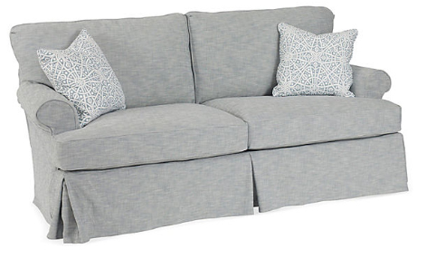 The rounded arm, casual look of the Sara slip covered sofa - perfect for napping!