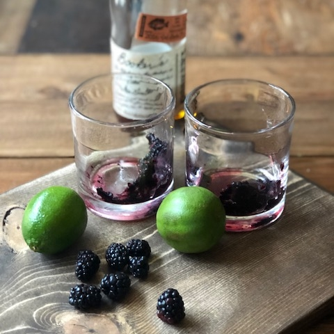 Blackberry, sage and Bourbon cocktail. The fruit is muddled and then mixed with Bourbon, sage simple syrup and fresh lime. Out of this world delicous and easy!