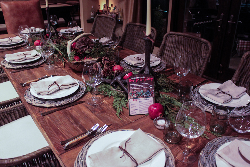 Christmas tablescape, wood, evergreens and pomegranate