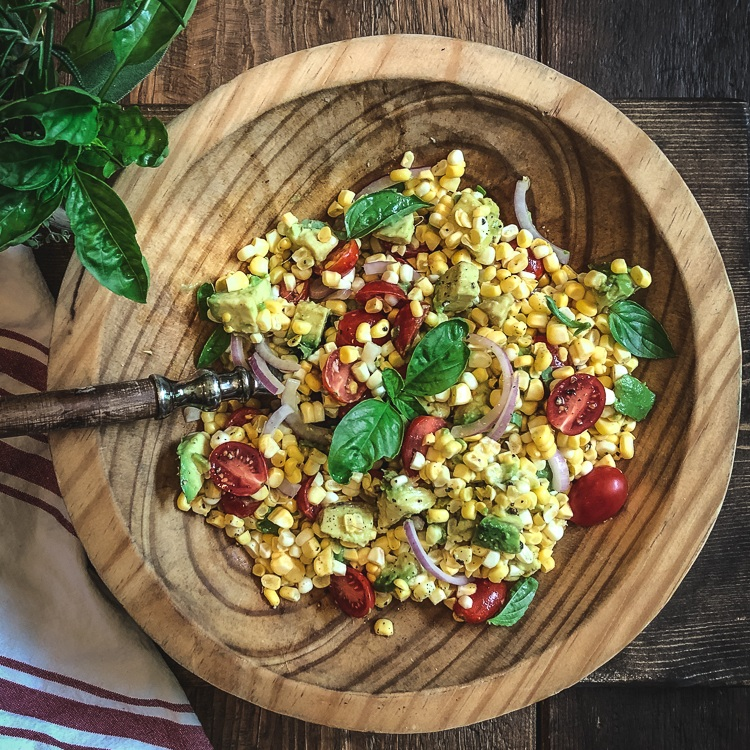 corn avocado salad wood table