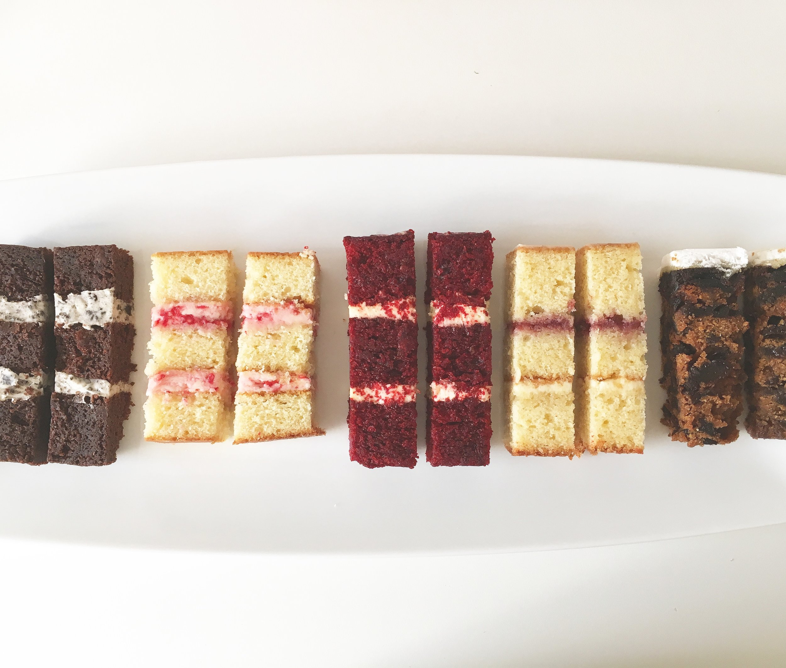 Cake flavours from left to right - Chocolate Oreo, White Chocolate & Raspberry, Red Velvet, Victoria Sponge, Classic Fruit Cake