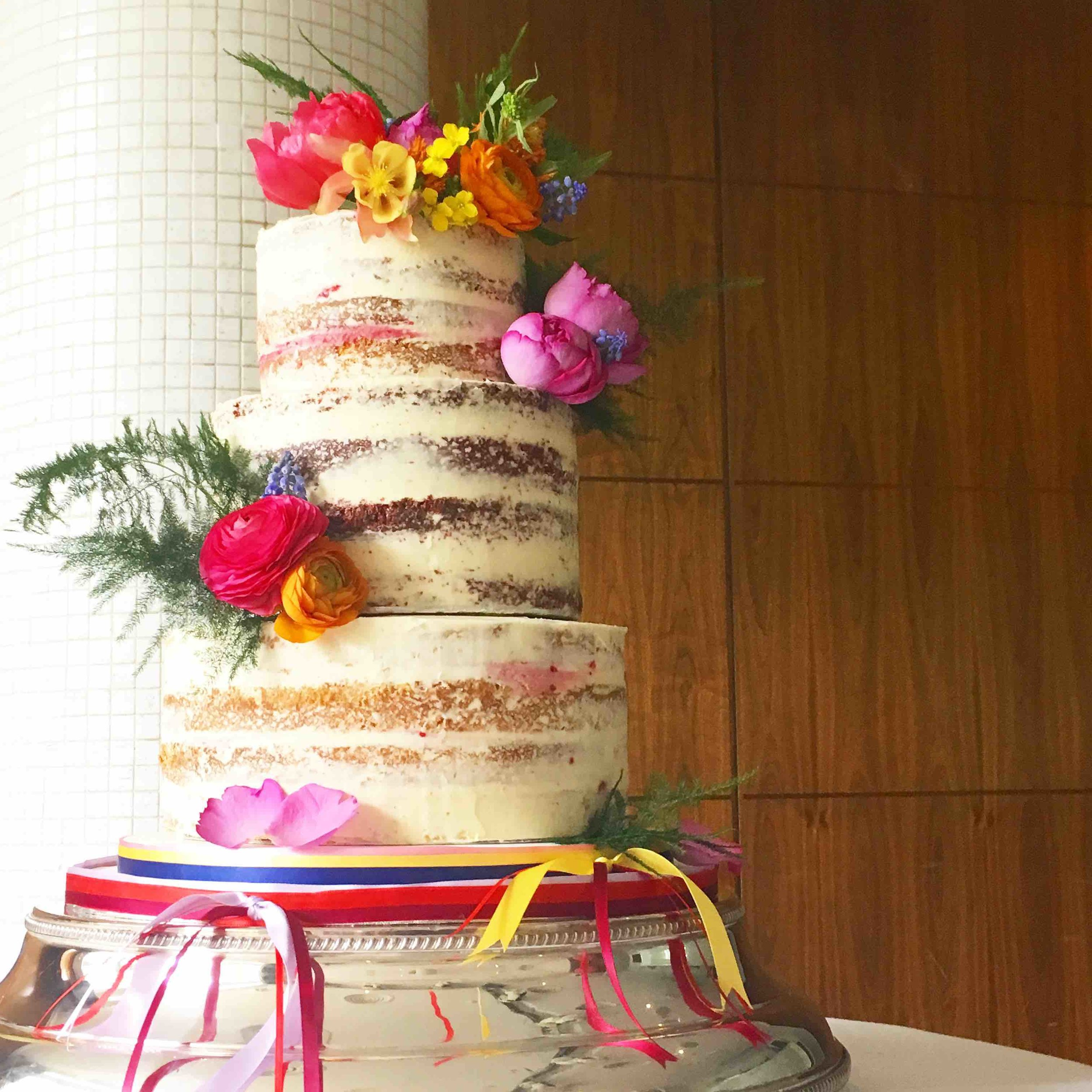 Bright semi-naked wedding cake
