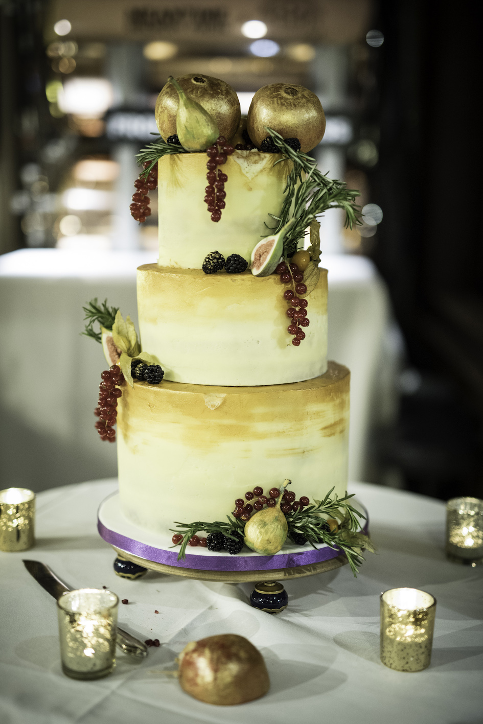 Gold buttercream wedding cake with fresh fruit