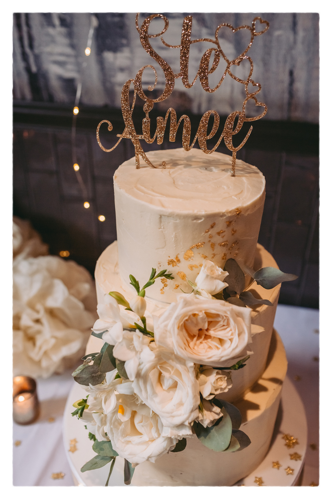 Buttercream wedding cake decorated with fresh flowers - photo by Alexander Newton Photography