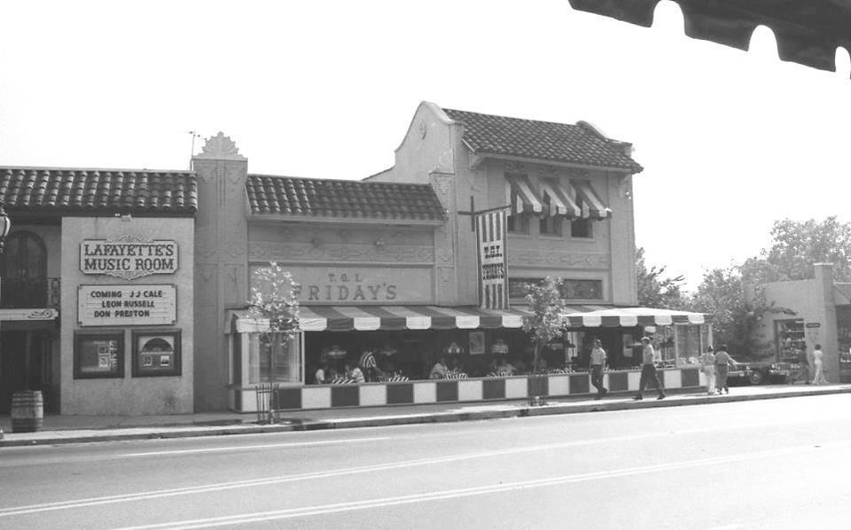 The second T.G.I. Friday's in the nation (pictured with red and white striped awnings) in Overton Square