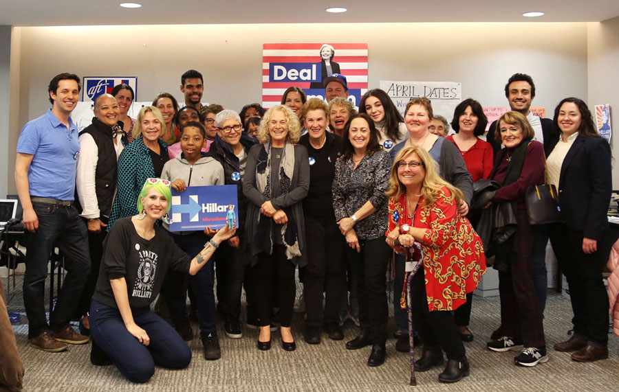Carol King poses for a photo with Volunteers in Manhattan on debate day, April 14, 2016.