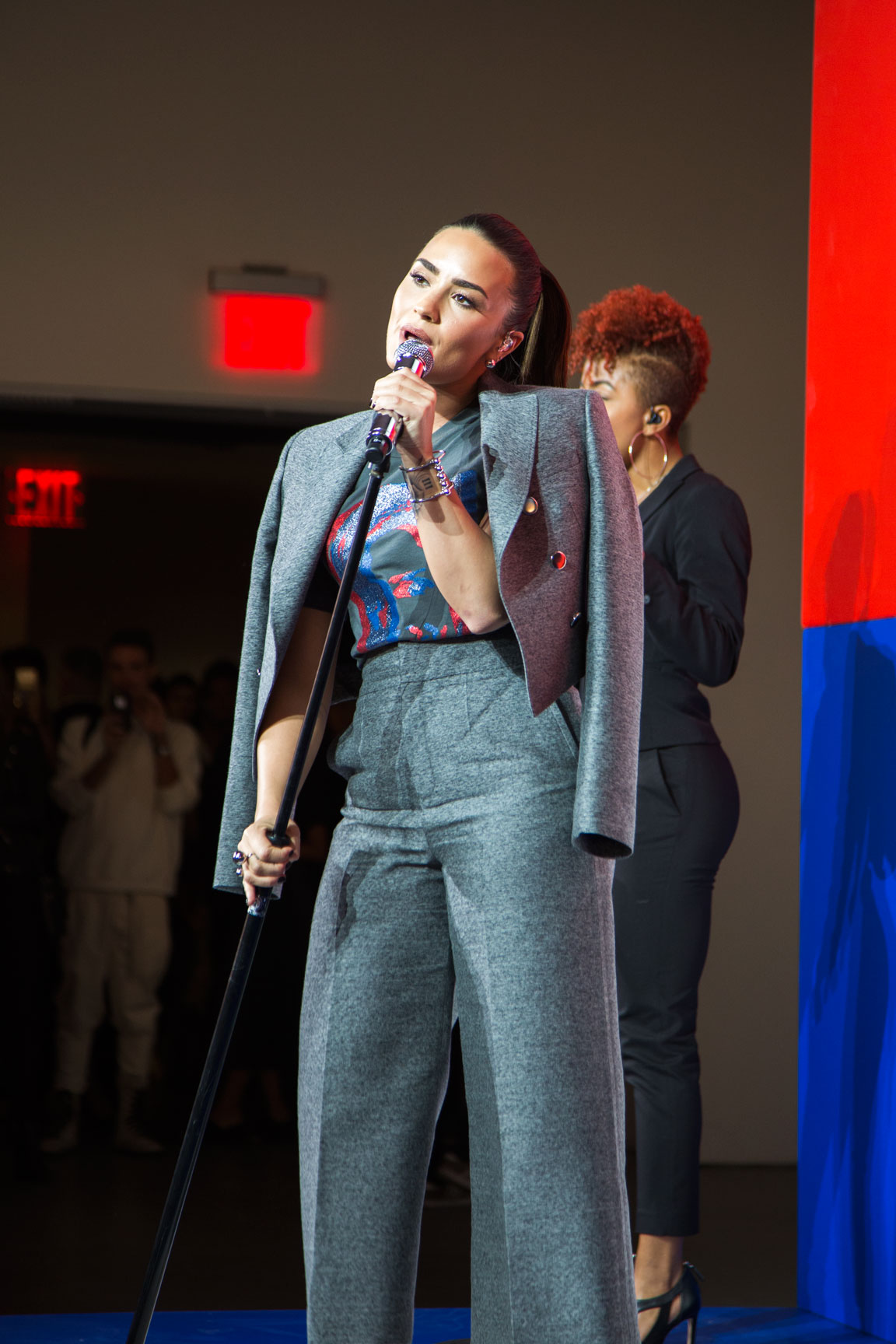 Demi Lovato singing Body Say, wearing Marc Jacobs for Hillary Clinton at New York Fashion Week. Photo by Kristen Blush.