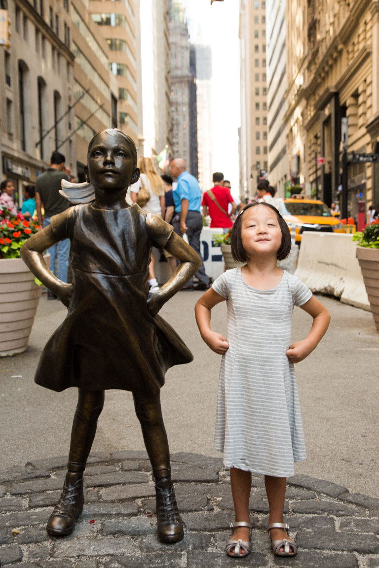 Fearless Girl statue and Lee Frederick. Photo by Kristen Blush.