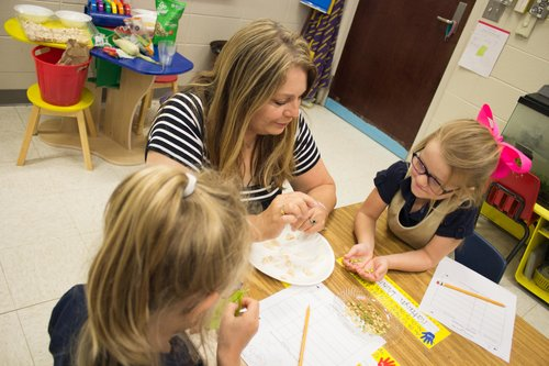 Parrino, the 2017 AITC Elementary Teacher of the Year, has her students explore the insides of a seed, to learn where their food comes from. Photo by Monica Velasquez.