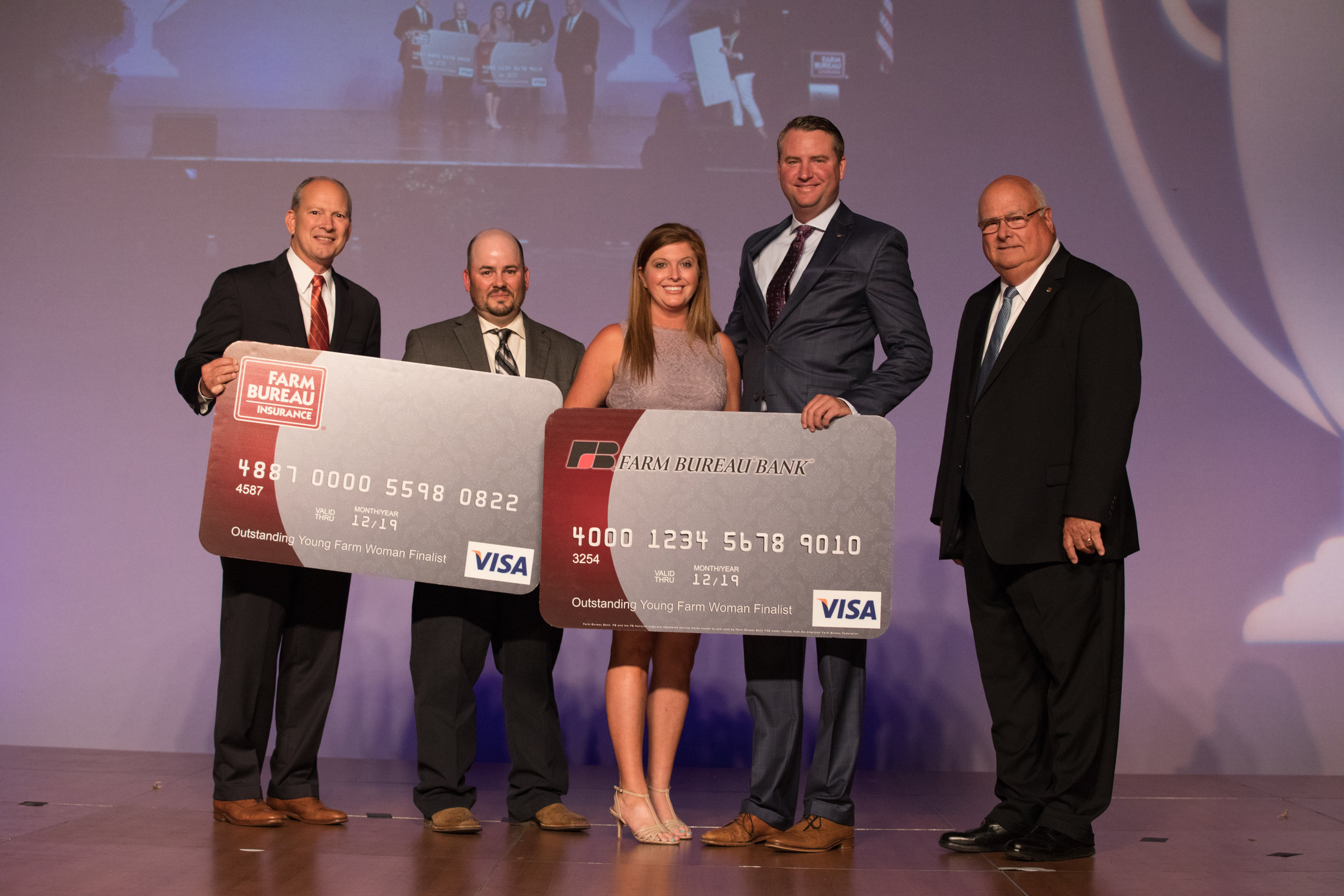 Pictured from left to right, Louisiana Farm Bureau Insurance Executive Vice President and State Manager, Blaine Briggs, Louisiana Farm Bureau Young Farmers and Ranchers Chair, Matt Gravois, 2018 Outstanding Young Farm Woman, Kacie Luckett, Louisiana Farm Bureau Insurance State Sales Manager, Will Waldrop, and Louisiana Farm Bureau Federation President Ronnie Anderson.