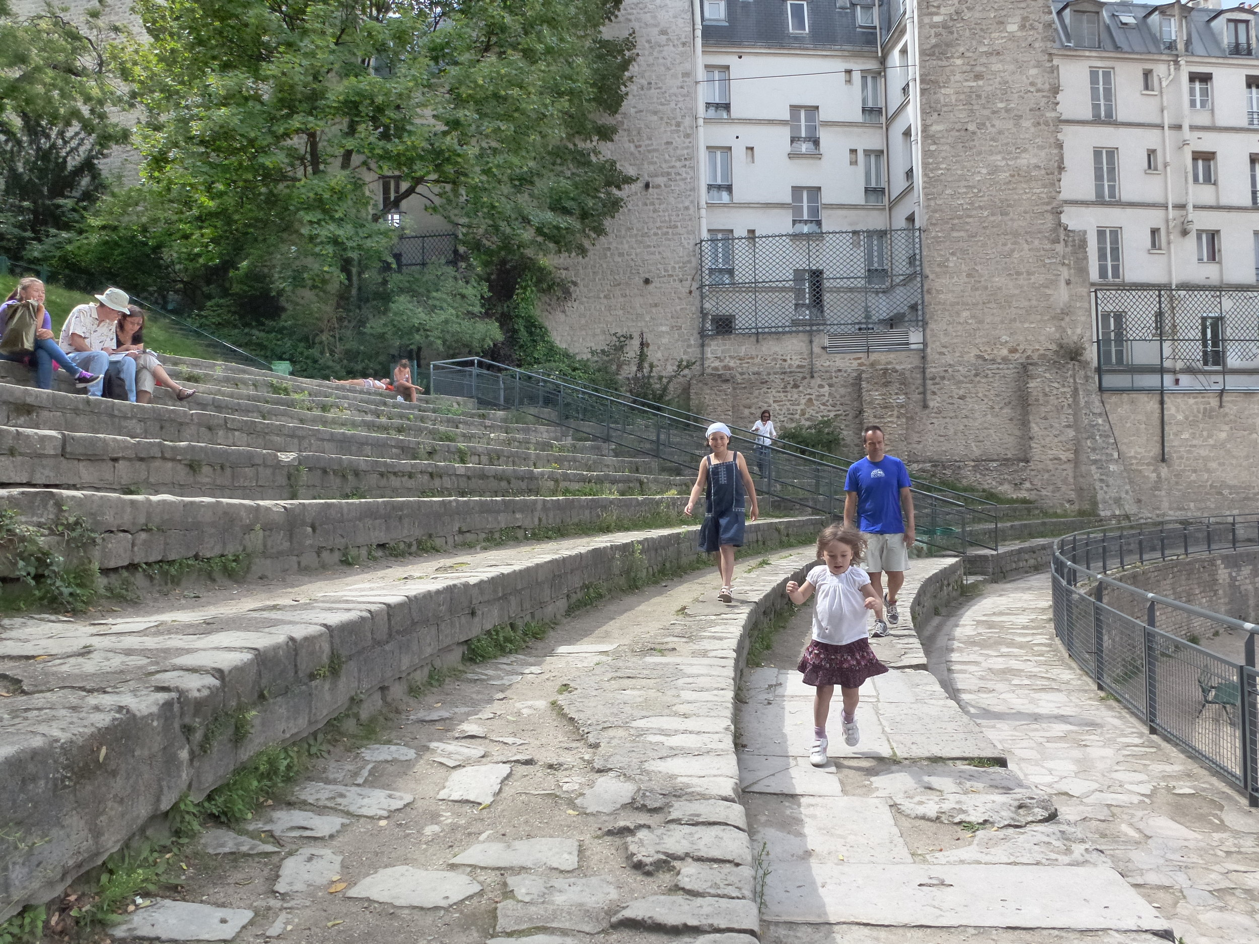 Clem, Franck, and Camille roaming around the steps where Romans used to lounge to watch gladiator fights.