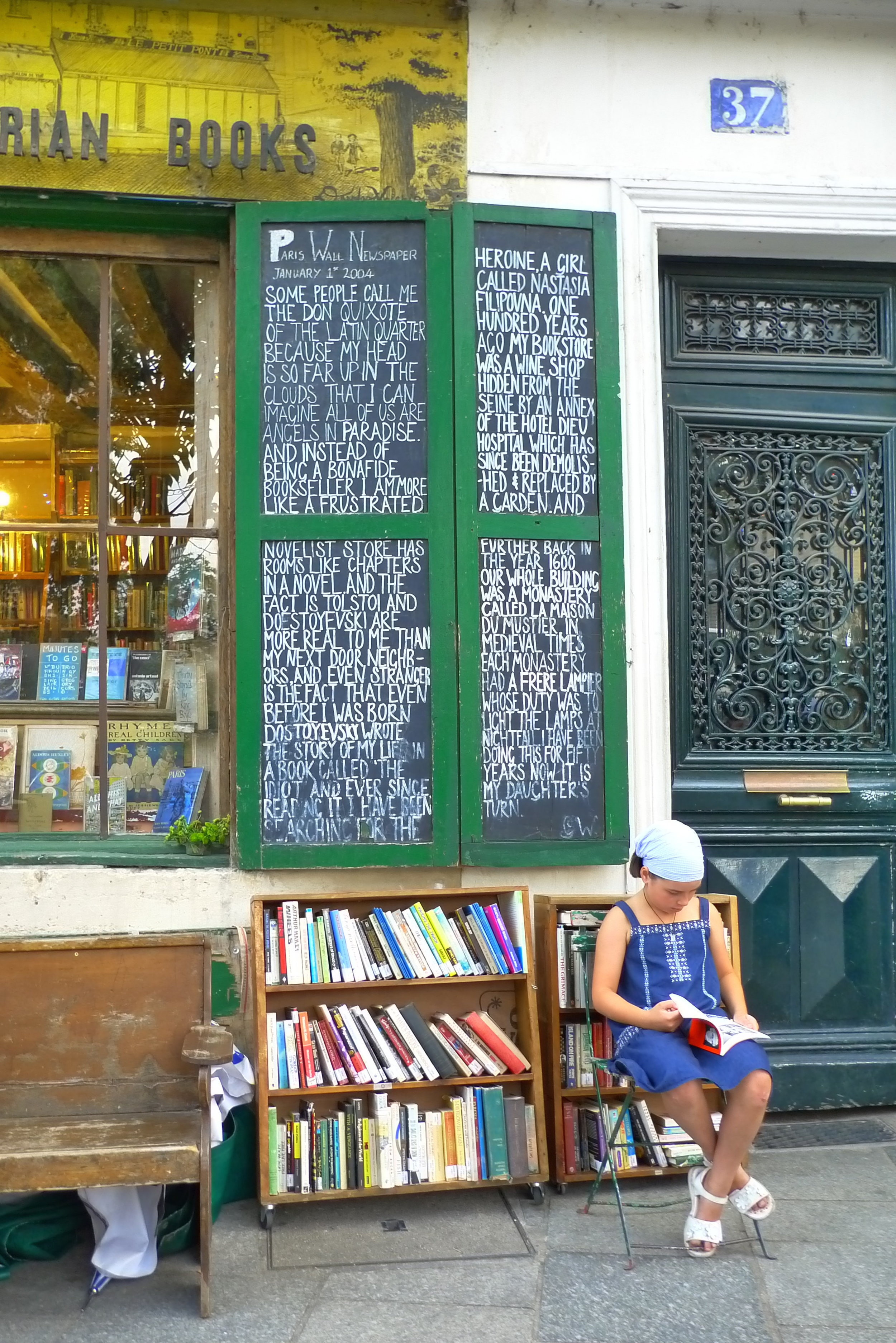 Camille checking out the books at Shakespeare & Co.