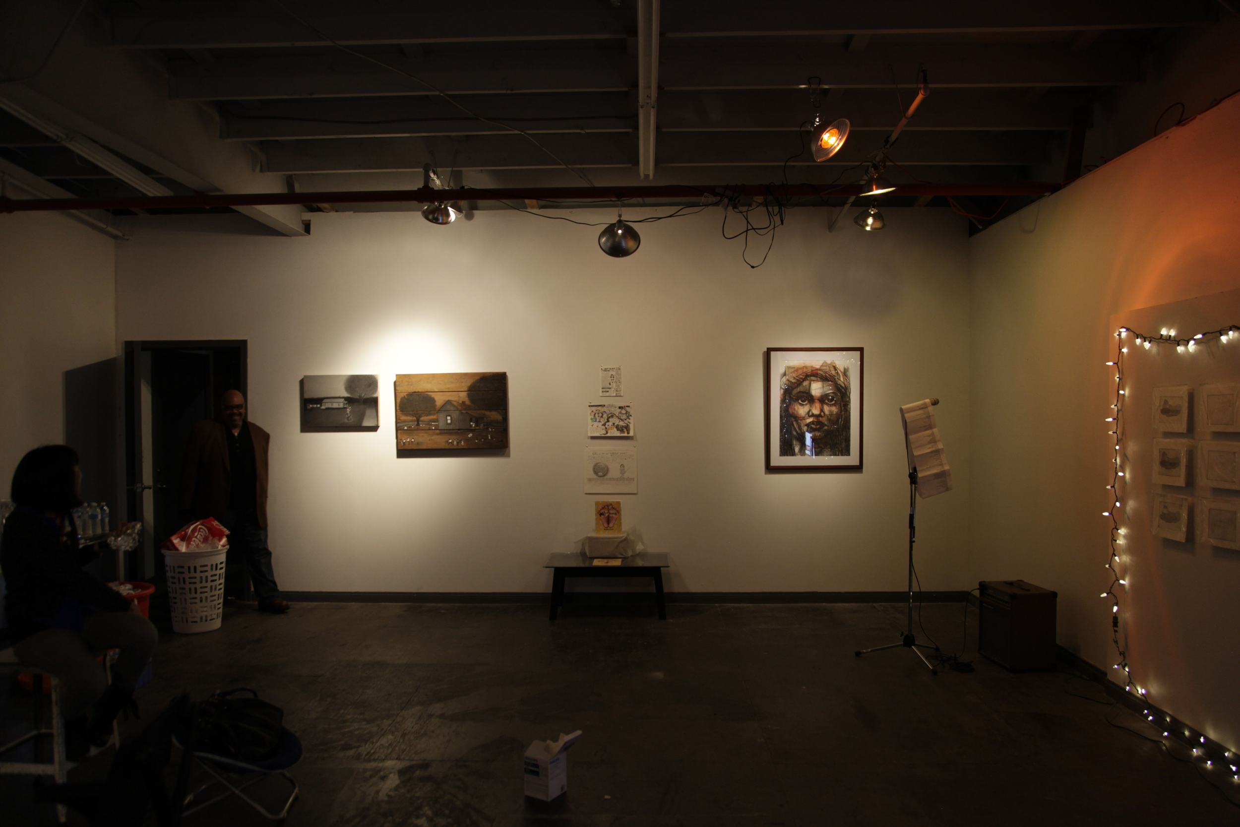 Installation View, from left to right,  Artists Victoria Tao, and Eric Myles.