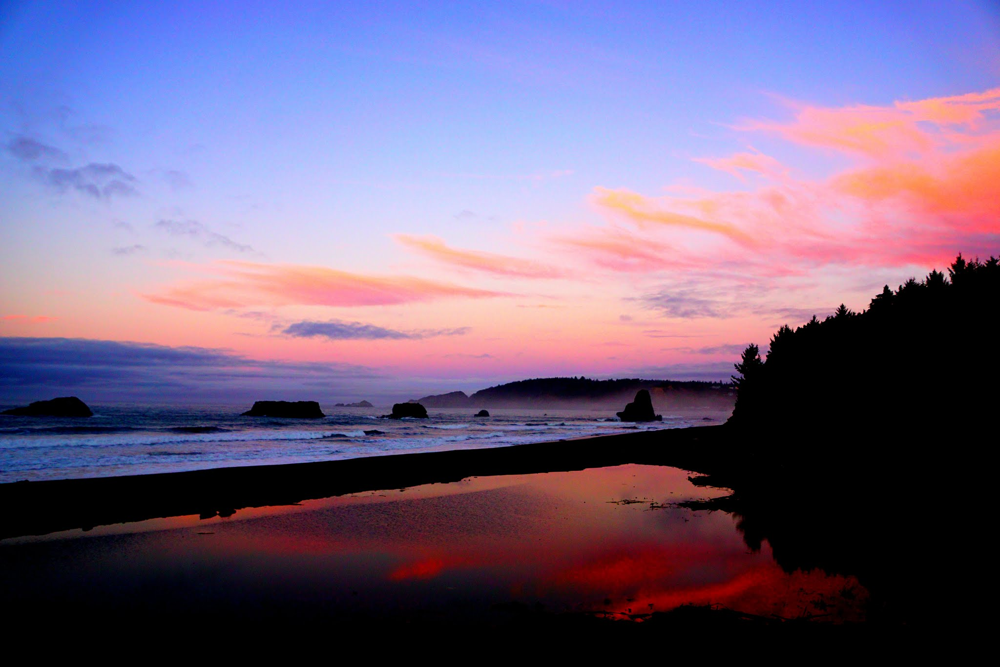 We are just four hours from the coast cities of Florence, Bandon, and Crescent City. The above picture was taken on a weekend trip to Port Orford, where residents camped on the beach. The Oregon Coast's Highway 101 is famous for its winding, verdant scenery and is dotted with towns both quaint and eclectic. Travel far enough north and you can visit the Tillamook Creamery and come home rich in cheese beyond your wildest dreams, travel south to find yourself among the Redwoods of northern California.