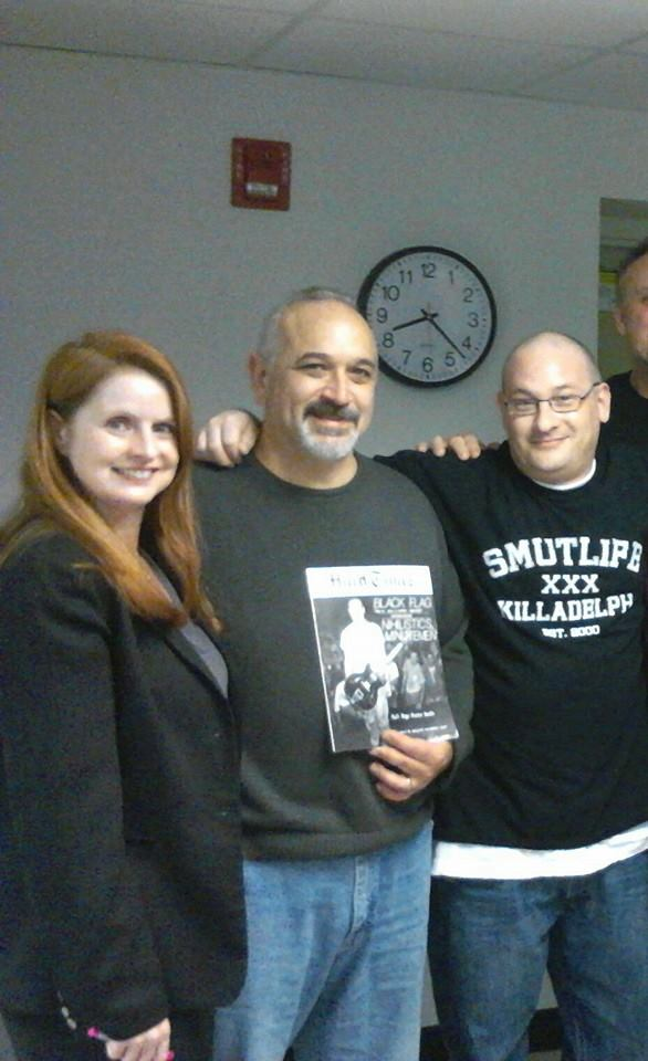 """Hard Times"" staff Amy Yates Wuelfing and Ron Gregorio with DiWulf's Steve DiLodovico"