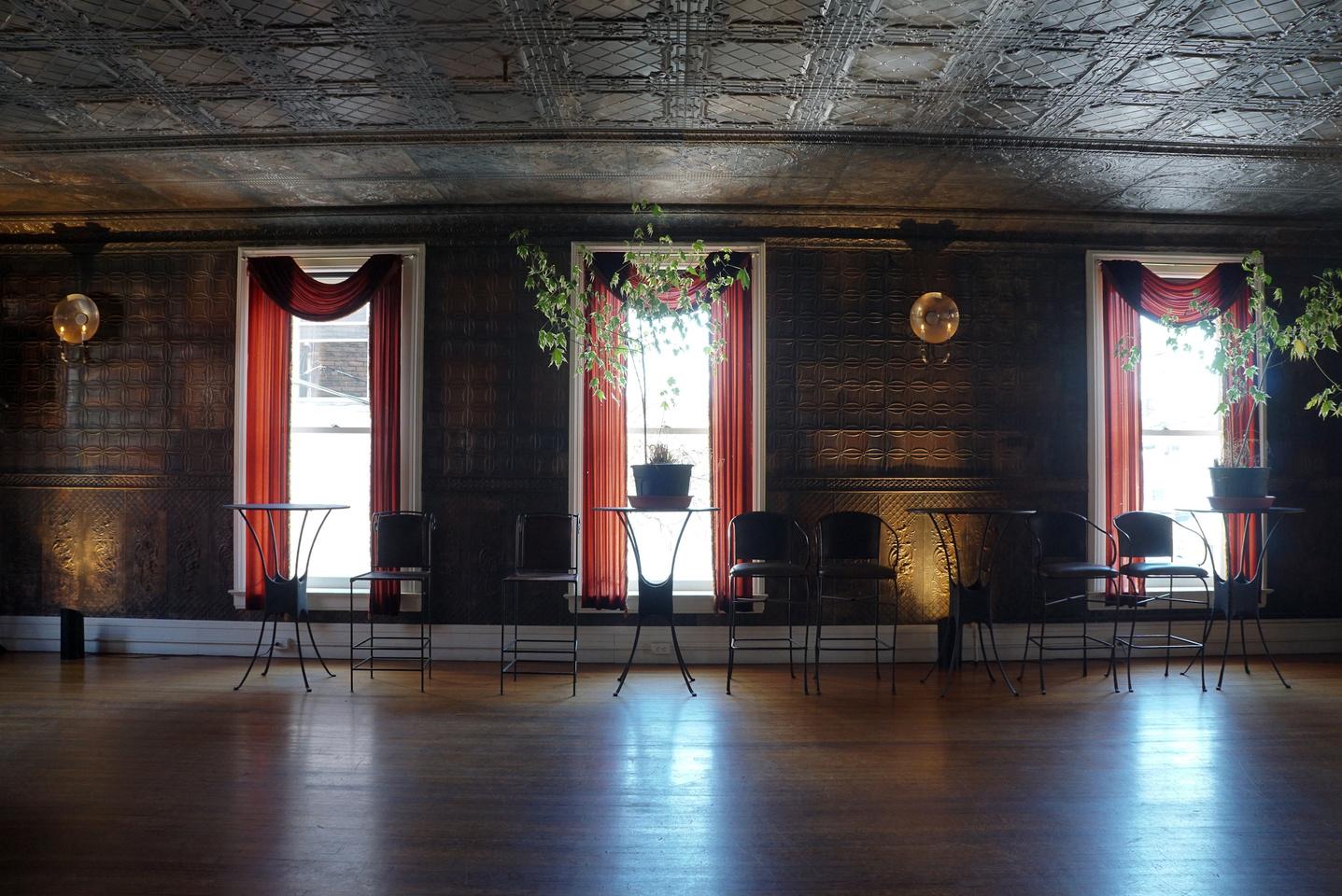 The ballroom still boasts its original tin walls and ceiling.