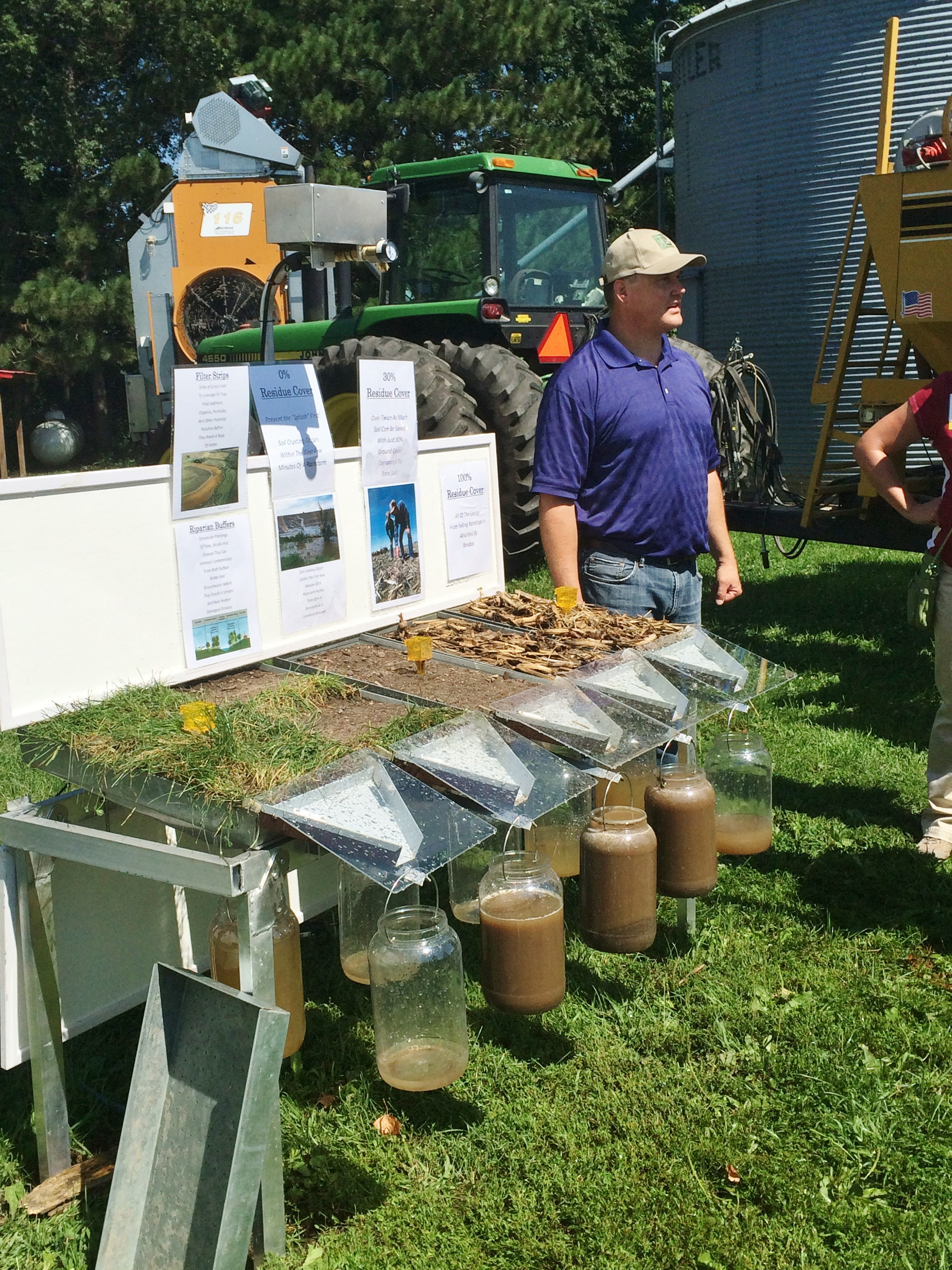 Demonstrating the effectiveness of buffers, as compared to bare soil or crop residue in keeping the soil on the land. Part of a tour at the Legvold farm in Northfield, MN sponsored by the Conservation Technology Information Center.