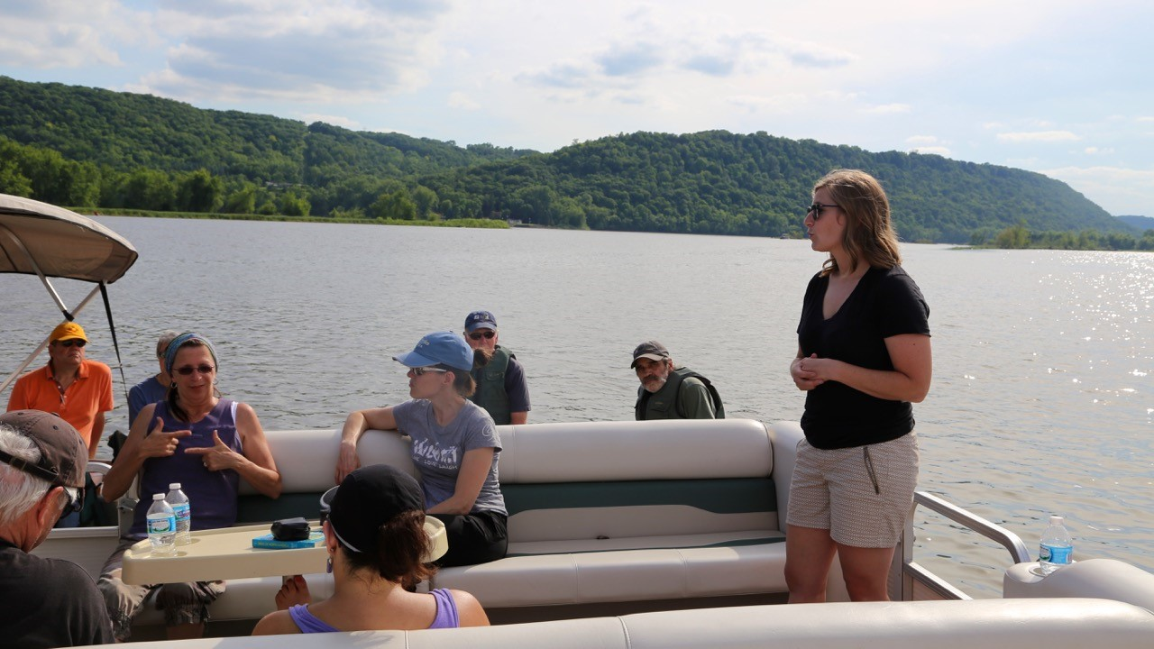 "Rylee Main leads ""Seeing Sediment"" Boat Tour with Lake Pepin artists and guests - Photo by Anne Queenan"