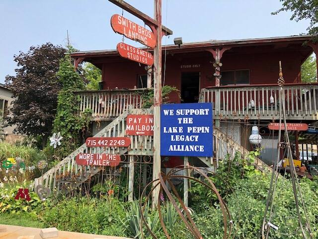 Dave and Jane Smith have a homemade LPLA sign posted outsider their metalwork shop in Pepin, WI.