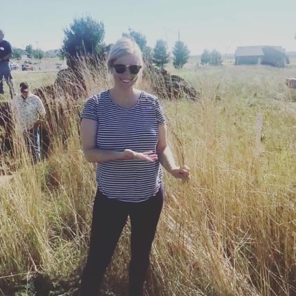 LPLA Executive Director, Rylee Main, touring an area planted with Kernza, an intermediate wheatgrass with long, dense root systems that reduce erosion, nutrient leaching, and high flows.